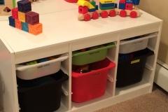 Playroom storage encourages clean-up!